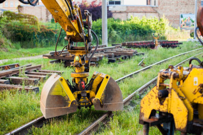 Railway construction equipment including hyralic shovel on rails