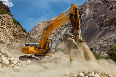 Excavator doing road construction in Himalayas. Ladakh, Jammu and Kashmir, India